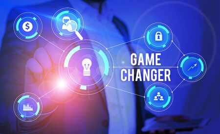 Word writing text Game Changer. Business photo showcasing Sports Data Scorekeeper Gamestreams Live Scores Team Admins Male human wear formal work suit presenting presentation using smart device