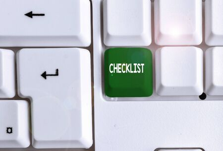 Conceptual hand writing showing Checklist. Concept meaning List down of the detailed activity as guide of doing something White pc keyboard with note paper above the white background