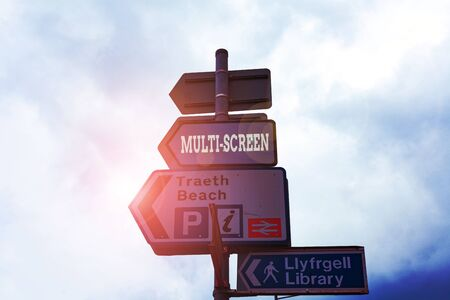 Text sign showing Multi Screen. Business photo text Having or involving several screen especially in a cinema Empty street signs on the crossroads with blank copy space Zdjęcie Seryjne