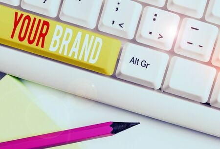 Handwriting text writing Your Brand. Conceptual photo A name of any kind that is impacted to something as trademark White pc keyboard with empty note paper above white background key copy space