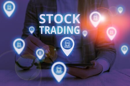 Text sign showing Stock Trading. Business photo text Buy and Sell of Securities Electronically on the Exchange Floor Woman wear formal work suit presenting presentation using smart device