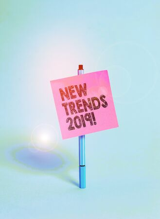 Handwriting text New Trends 2019. Conceptual photo general direction in which something is developing Ballpoint blank colored sticky note peaceful cool pastel fashion background