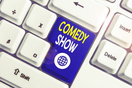 Writing note showing Comedy Show. Business concept for Funny program Humorous Amusing medium of Entertainment White pc keyboard with note paper above the white background