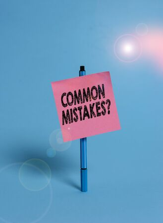 Handwriting text Common Mistakes Question. Conceptual photo repeat act or judgement misguided making something wrong Ballpoint blank colored sticky note peaceful cool pastel fashion background