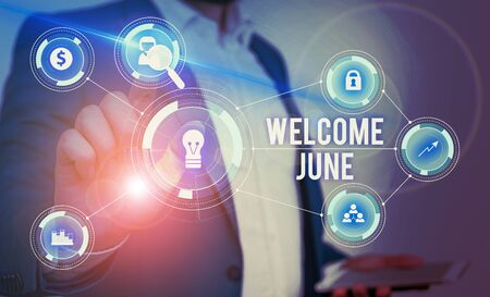 Word writing text Welcome June. Business photo showcasing Calendar Sixth Month Second Quarter Thirty days Greetings Male human wear formal work suit presenting presentation using smart device Foto de archivo