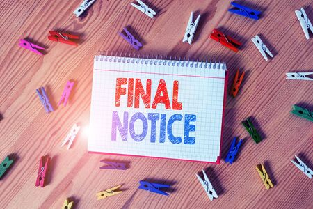 Conceptual hand writing showing Final Notice. Concept meaning Formal Declaration or warning that action will be taken Colored crumpled papers wooden floor background clothespin