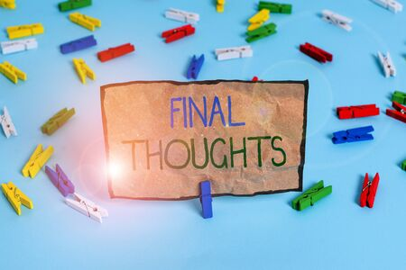 Handwriting text writing Final Thoughts. Conceptual photo the conclusion or last few sentences within your conclusion Colored clothespin papers empty reminder blue floor background office pin