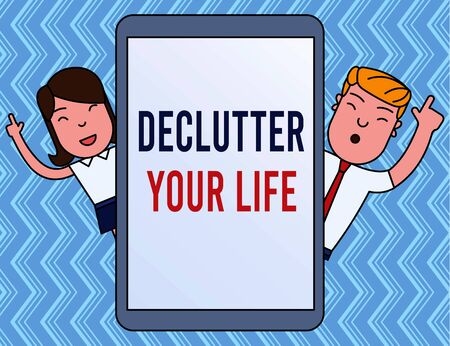 Writing note showing Declutter Your Life. Business concept for To eliminate extraneous things or information in life Male and Female Index Fingers Up Touch Screen Tablet Smartphone Device Stok Fotoğraf
