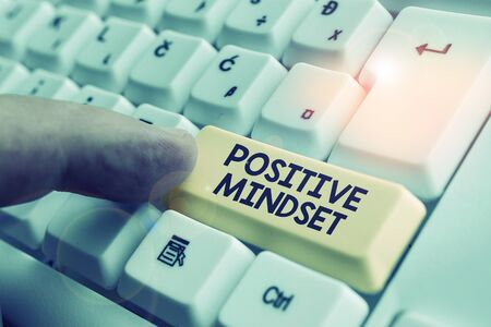 Writing note showing Positive Mindset. Business concept for mental attitude in wich you expect favorable results White pc keyboard with note paper above the white background