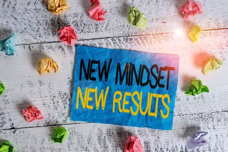 Word writing text New Mindset New Results. Business photo showcasing obstacles are opportunities to reach achievement Crumpled colored rectangle square shaped paper reminder white wood desk
