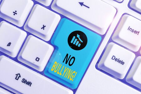Word writing text No Bullying. Business photo showcasing stop aggressive behavior among children power imbalance White pc keyboard with empty note paper above white background key copy space