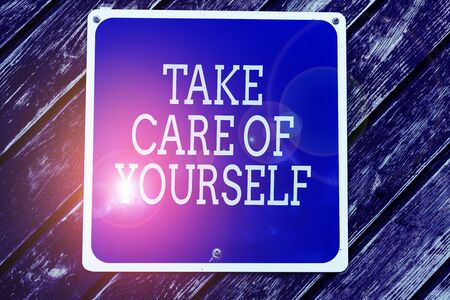 Handwriting text writing Take Care Of Yourself. Conceptual photo a polite way of ending a gettogether or conversation Empty blue board with copy space above wooden background