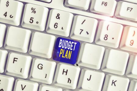Conceptual hand writing showing Budget Plan. Concept meaning financial schedule for a defined period of time usually year White pc keyboard with note paper above the white background