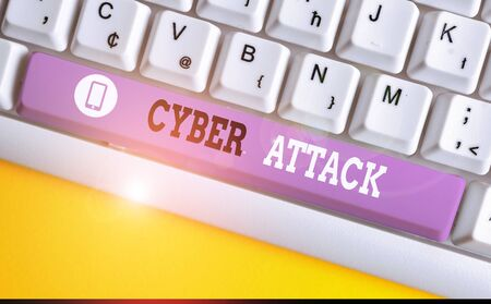 Conceptual hand writing showing Cyber Attack. Concept meaning An attempt by hackers to Damage Destroy a Computer System White pc keyboard with note paper above the white background Stock Photo