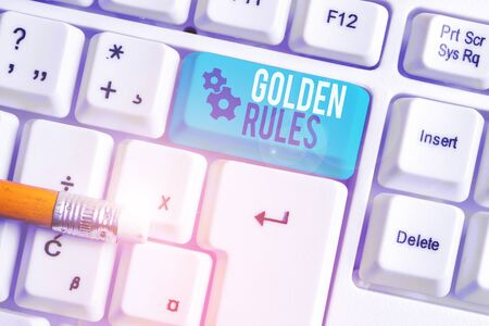 Writing note showing Golden Rules. Business concept for Basic principle that should be followed Important Principle White pc keyboard with note paper above the white background