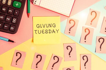 Conceptual hand writing showing Giving Tuesday. Concept meaning international day of charitable giving Hashtag activism Mathematics stuff and writing equipment on pastel background