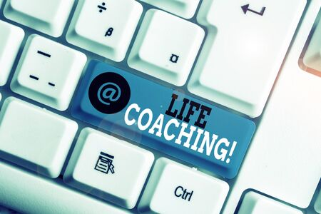Text sign showing Life Coaching. Business photo showcasing demonstrating employed to help showing attain their goals in career White pc keyboard with empty note paper above white background key copy space Stock Photo