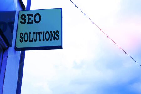 Word writing text Seo Solutions. Business photo showcasing Search Engine Result Page Increase Visitors by Rankings Green ad board on the street with copy space for advertisement Stock Photo