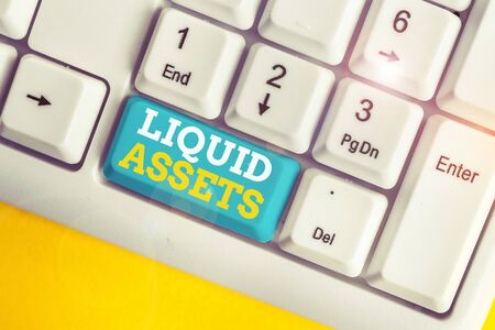 Writing note showing Liquid Assets. Business concept for Cash and Bank Balances Market Liquidity Deferred Stock White pc keyboard with note paper above the white background