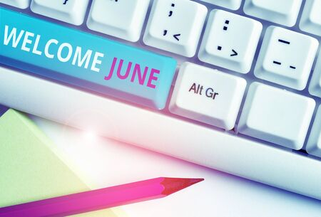 Handwriting text Welcome June. Conceptual photo Calendar Sixth Month Second Quarter Thirty days Greetings White pc keyboard with empty note paper above white background key copy space