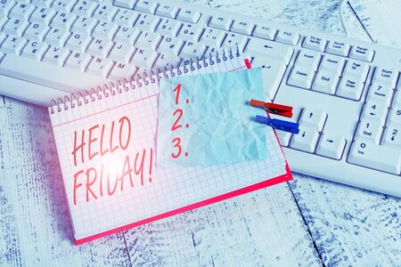 Text sign showing Hello Friday. Business photo showcasing used to express happiness from beginning of fresh week notebook paper reminder clothespin pinned sheet white keyboard light wooden Imagens