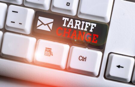 Conceptual hand writing showing Tariff Change. Concept meaning Amendment of Import Export taxes for goods and services White pc keyboard with note paper above the white background