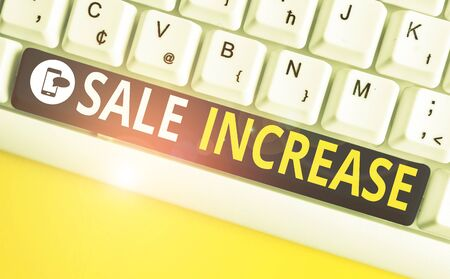 Conceptual hand writing showing Sale Increase. Concept meaning Average Sales Volume has Grown Boost Income from Leads White pc keyboard with note paper above the white background