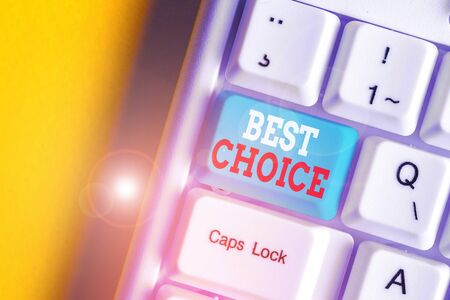 Writing note showing Best Choice. Business concept for act of picking or deciding between two or more possibilities White pc keyboard with note paper above the white background Imagens