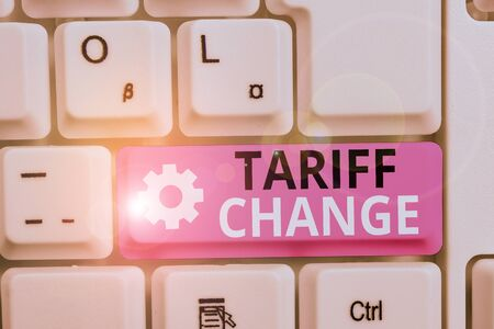 Writing note showing Tariff Change. Business concept for Amendment of Import Export taxes for goods and services White pc keyboard with note paper above the white background Stockfoto