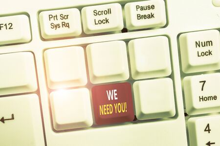 Conceptual hand writing showing We Need You. Concept meaning asking someone to work together for certain job or target White pc keyboard with note paper above the white background Imagens