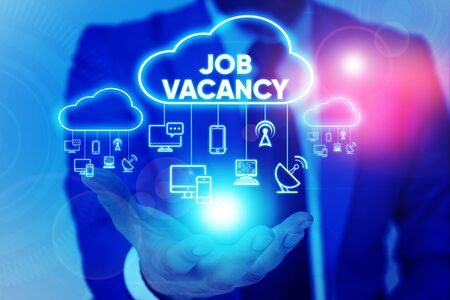 Handwriting text Job Vacancy. Conceptual photo empty or available paid place in small or big company Male human wear formal work suit presenting presentation using smart device