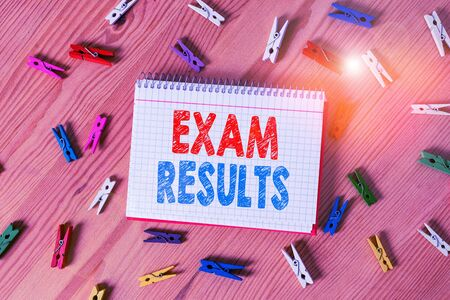 Conceptual hand writing showing Exam Results. Concept meaning An outcome of a formal test that shows knowledge or ability Colored crumpled papers wooden floor background clothespin