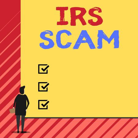Handwriting text writing Irs Scam. Conceptual photo targeted taxpayers by pretending to be Internal Revenue Service Man stands in back view in front of huge empty blank big rectangle board
