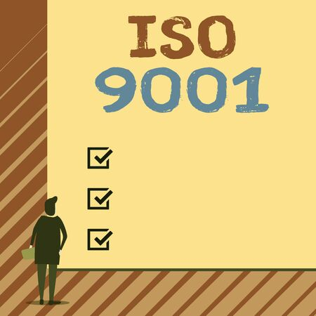 Handwriting text writing Iso 9001. Conceptual photo designed help organizations to ensure meet the needs of customers Man stands in back view in front of huge empty blank big rectangle board Stok Fotoğraf
