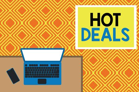 Conceptual hand writing showing Hot Deals. Concept meaning An agreement through which one of the paties is offered and accept Office working place laptop lying wooden desk smartphone