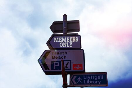 Text sign showing Members Only. Business photo text Limited to an individual belongs to a group or an organization Empty street signs on the crossroads with blank copy space Banco de Imagens