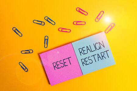 Writing note showing Reset Realign Restart. Business concept for Life audit will help you put things in perspectives Colored square blank sticky notepads sheets clips color background 写真素材 - 132120542
