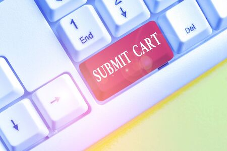 Word writing text Submit Cart. Business photo showcasing Sending shopping list of online items Proceed checkout White pc keyboard with empty note paper above white background key copy space