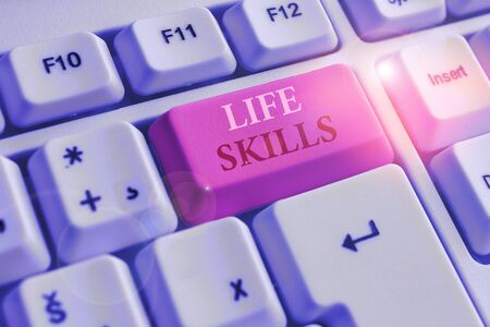 Text sign showing Life Skills. Business photo text skill that is necessary for full participation in everyday life White pc keyboard with empty note paper above white background key copy space 版權商用圖片