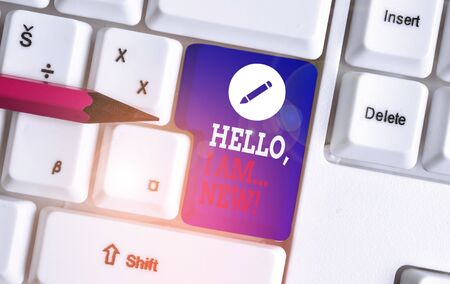 Writing note showing Hello I Am New. Business concept for used greeting or begin telephone conversation White pc keyboard with note paper above the white background Banco de Imagens