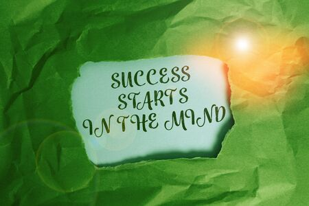 Text sign showing Success Starts In The Mind. Business photo text set your mind to positivity it can go a long way Green crumpled ripped colored paper sheet centre torn colorful background