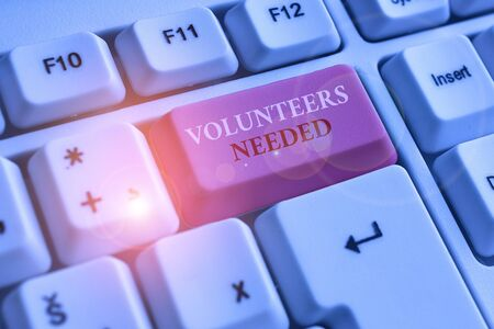 Text sign showing Volunteers Needed. Business photo text need work or help for organization without being paid White pc keyboard with empty note paper above white background key copy space