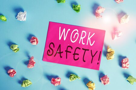 Writing note showing Work Safety. Business concept for policies and procedures in place to ensure health of employees Colored crumpled rectangle shaped reminder paper light blue background