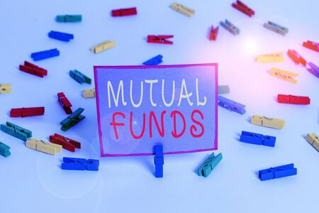 Conceptual hand writing showing Mutual Funds. Concept meaning An investment program funded by shareholders Individual Stocks Colored clothespin papers empty reminder white floor office