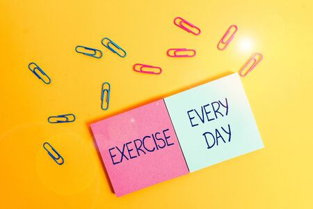 Writing note showing Exercise Every Day. Business concept for move body energetically in order to get fit and healthy Colored square blank sticky notepads sheets clips color background