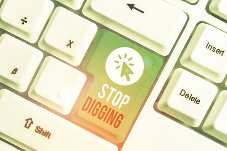 Writing note showing Stop Digging. Business concept for Prevent Illegal excavation quarry Environment Conservation White pc keyboard with note paper above the white background