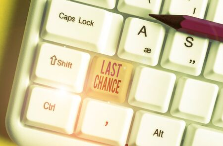 Conceptual hand writing showing Last Chance. Concept meaning final opportunity to achieve or acquire something or action White pc keyboard with note paper above the white background