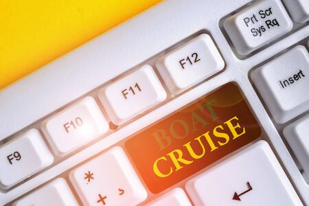 Handwriting text Boat Cruise. Conceptual photo sail about in area without precise destination with large ship White pc keyboard with empty note paper above white background key copy space