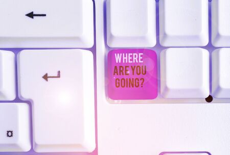 Conceptual hand writing showing Where Are You Goingquestion. Concept meaning used to ask someone the destination headed to White pc keyboard with note paper above the white background