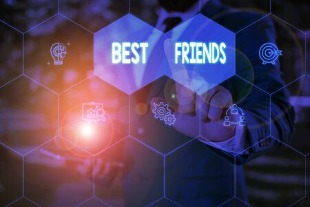 Word writing text Best Friends. Business photo showcasing A demonstrating you value above other demonstratings Forever buddies Male human wear formal work suit presenting presentation using smart devi